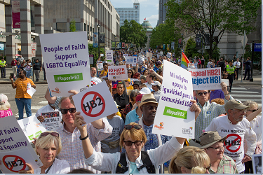 Demonstrators call for the repeal of HB2 in Raleigh, N.C., on April 25, 2016. The state marks the first anniversary the bill, widely criticized as anti-LGBT, which has cost North Carolinians jobs, money, performances and events, including this montha s NCAA basketball tournament. (Jill Knight/Raleigh News & Observer/TNS)