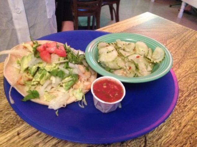 Sauteed shrimp and avocado taco special with cucumber salad.