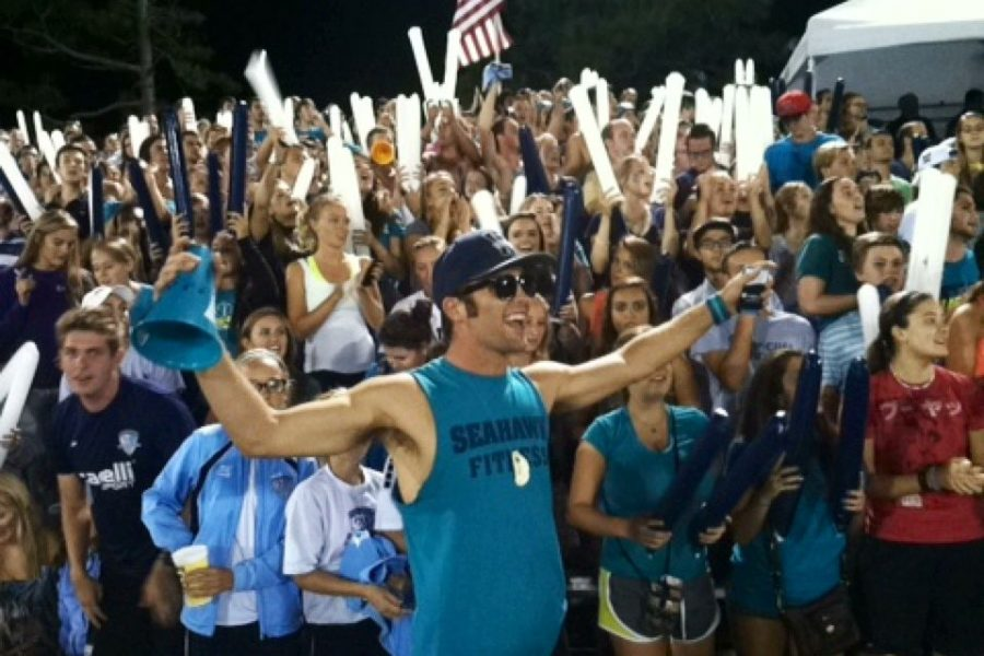Parker G leads a record-crowd in cheers during the mens soccer game against UNC earlier this year.