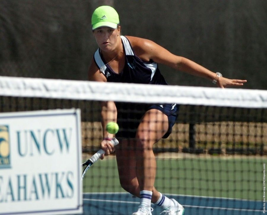 Senior Miller Hales fights for a point during UNCW's 5-2 victory over JMU earlier this season.