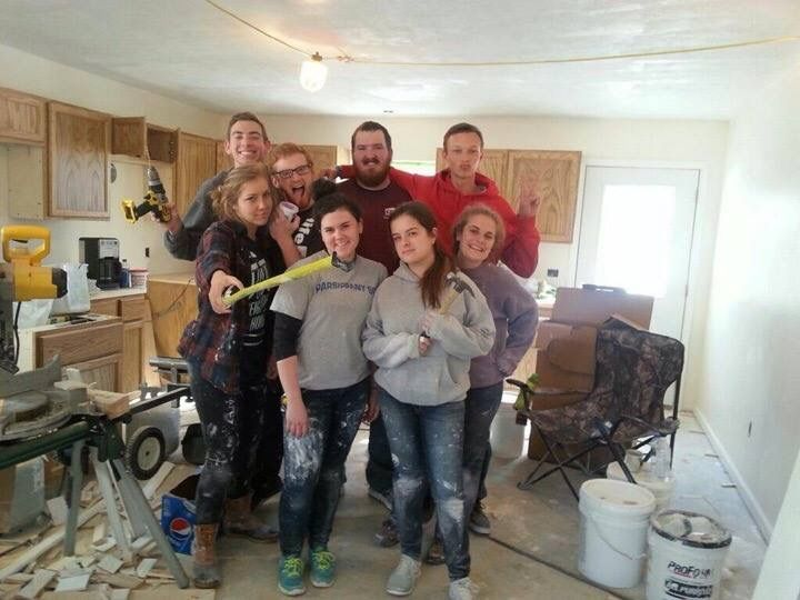 The UNCW Habitat for Humanity volunteers help build a house in Michigan.