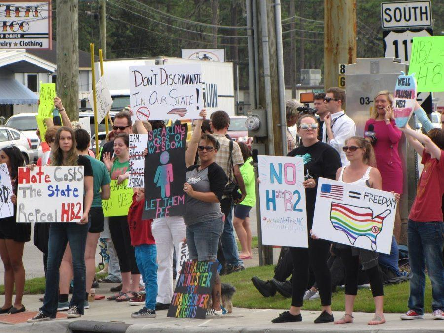 Members of the Wilmington community rally in opposition to House Bill 2, a new law in North Carolina, passed last week.