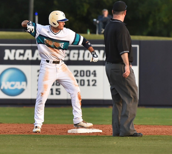 Robbie+Thorburn+rises+from+the+ground+after+sliding+safely+into+second+base+in+UNCW%27s+victory+last+Friday+over+Hofstra.