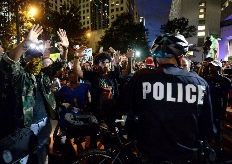 Protestors+confront+bicycle+officers+along+Trade+Street+in+Charlotte%2C+N.C.%2C+on+Wednesday%2C+Sept.+21%2C+2016.+The+protestors+were+rallying+against+the+fatal+shooting+of+Keith+Lamont+Scott+by+police+on+Tuesday+evening+in+the+University+City+area.+%28Jeff+Siner%2FThe+Charlotte+Observer%2FTNS%29