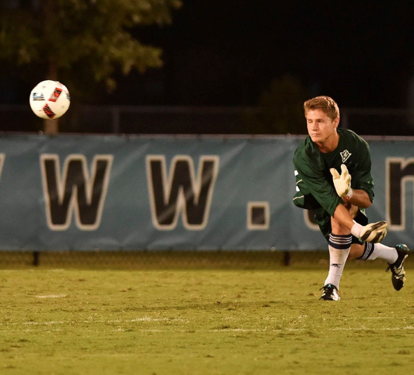 Ryan Cretens, above, hurls the ball away from UNCW's goal post during Friday's 3-0 win over Dayton.