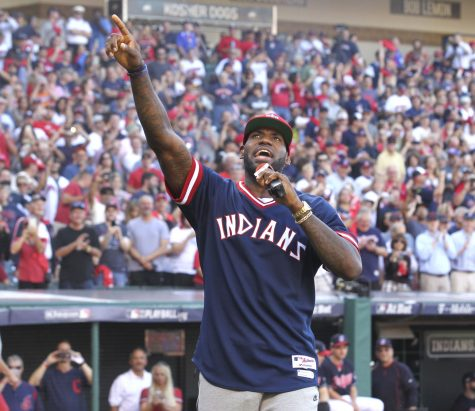 The Cleveland Cavaliers' LeBron James gets the home crowd pumped before the Cleveland Indians meet the Boston Red Sox in Game 2 of the American League Division Series on Friday, Oct. 7, 2016, at Progressive Field in Cleveland. The Tribe won, 6-0, and now lead the series, 2-0. (Phil Masturzo/Akron Beacon Journal/TNS)