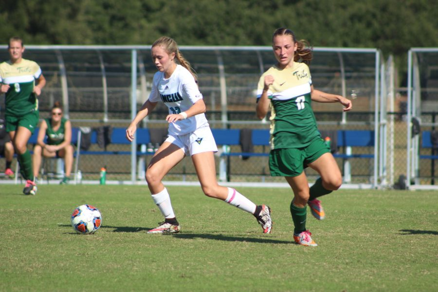 Brittany Matsinger dribbles the ball around a William & Mary defender during Sunday's CAA Tournament game.