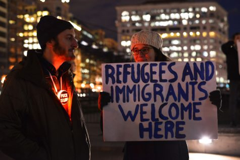 Activists in downtown Washington, D.C. protest President Donald Trump's proposed executive order Thursday, Jan. 26, 2017, which would halt refugee admissions for 4 months, and suspend or ban entry to the U.S. from many Muslim majority countries. Activists call the order a