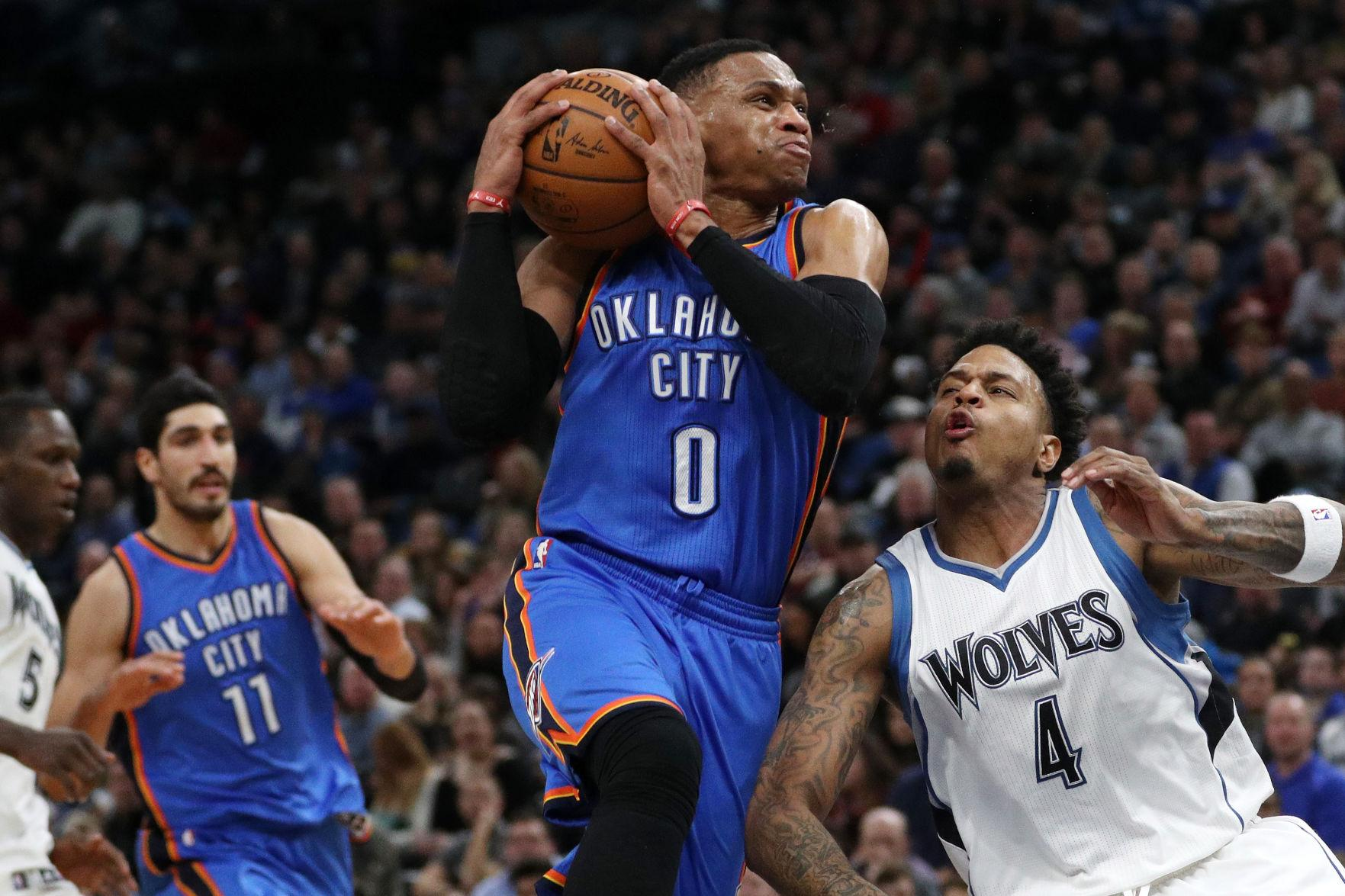 The Oklahoma City Thunder's Russell Westbrook (0) drives to the basket against the Minnesota Timberwolves' Brandon Rush (4) during the second half on Friday, Jan. 13, 2017, at the Target Center in Minneapolis. The Timberwolves won, 96-86. (Anthony Souffle/Minneapolis Star Tribune/TNS)