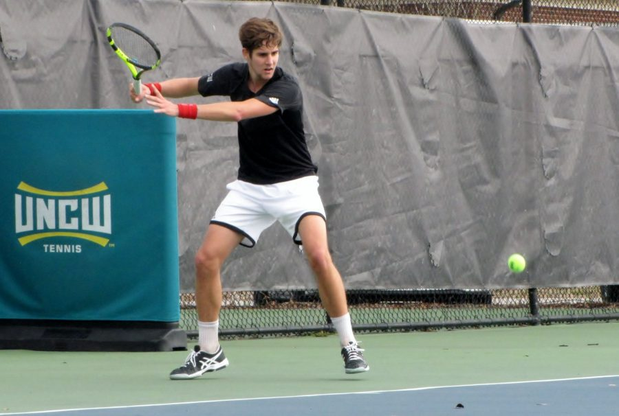 UNCW freshman Ignasi de Reuda, who played No. 4 singles for the Seahawks versus USF, readies his forehand against Appalachian State on Jan. 21.