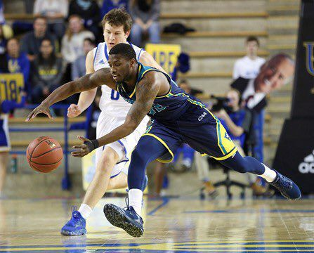 Ambrose Mosley grabs for a ball in UNCW's away game at Drexel on Jan. 5. The Seahawks secured a regular-season sweep of the Dragons in a 87-74 home win on Saturday.