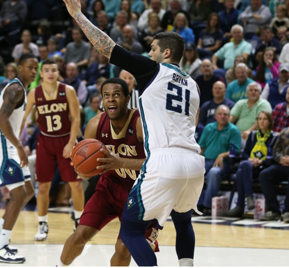 Marcus Bryan (21) defends against an Elon ball handler in last Monday's 79-63 CAA win.