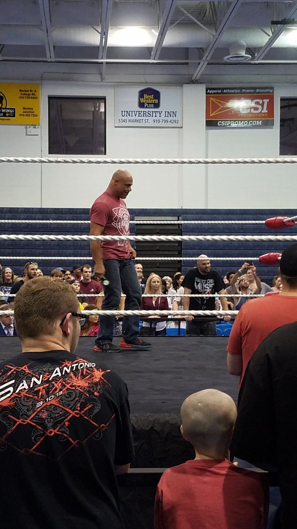 Kurt Angle stands in-ring during