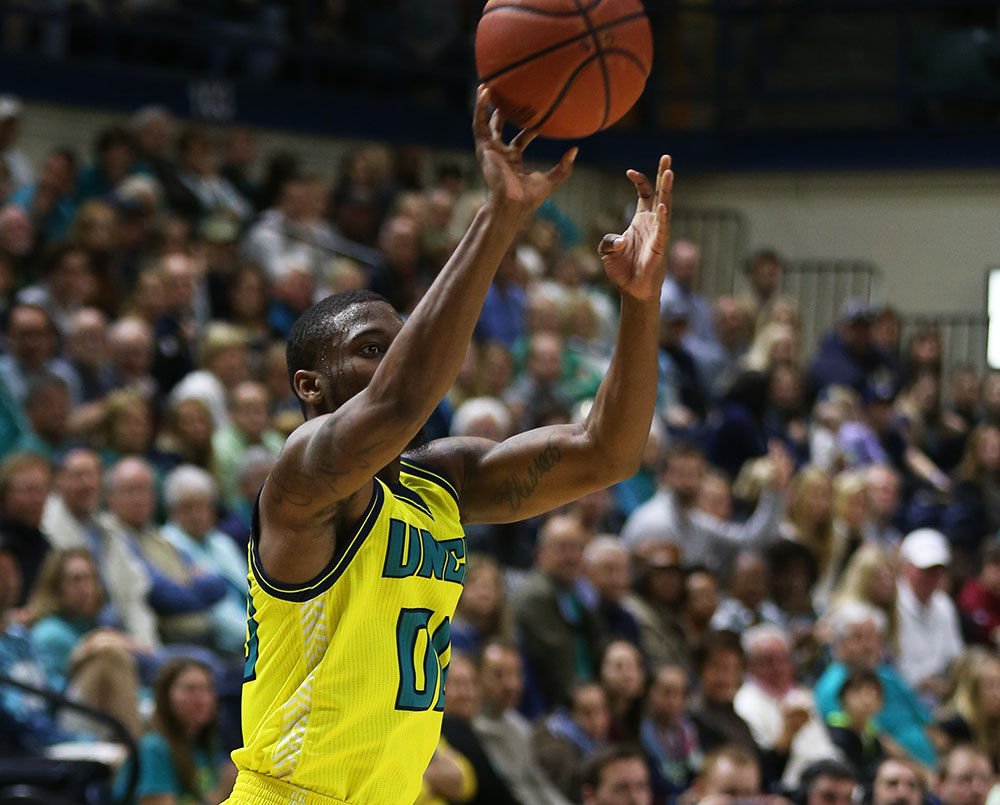 Ambrose Mosley uncorks one of six made three-pointers in Saturday's 108-80 blowout win over Delaware.