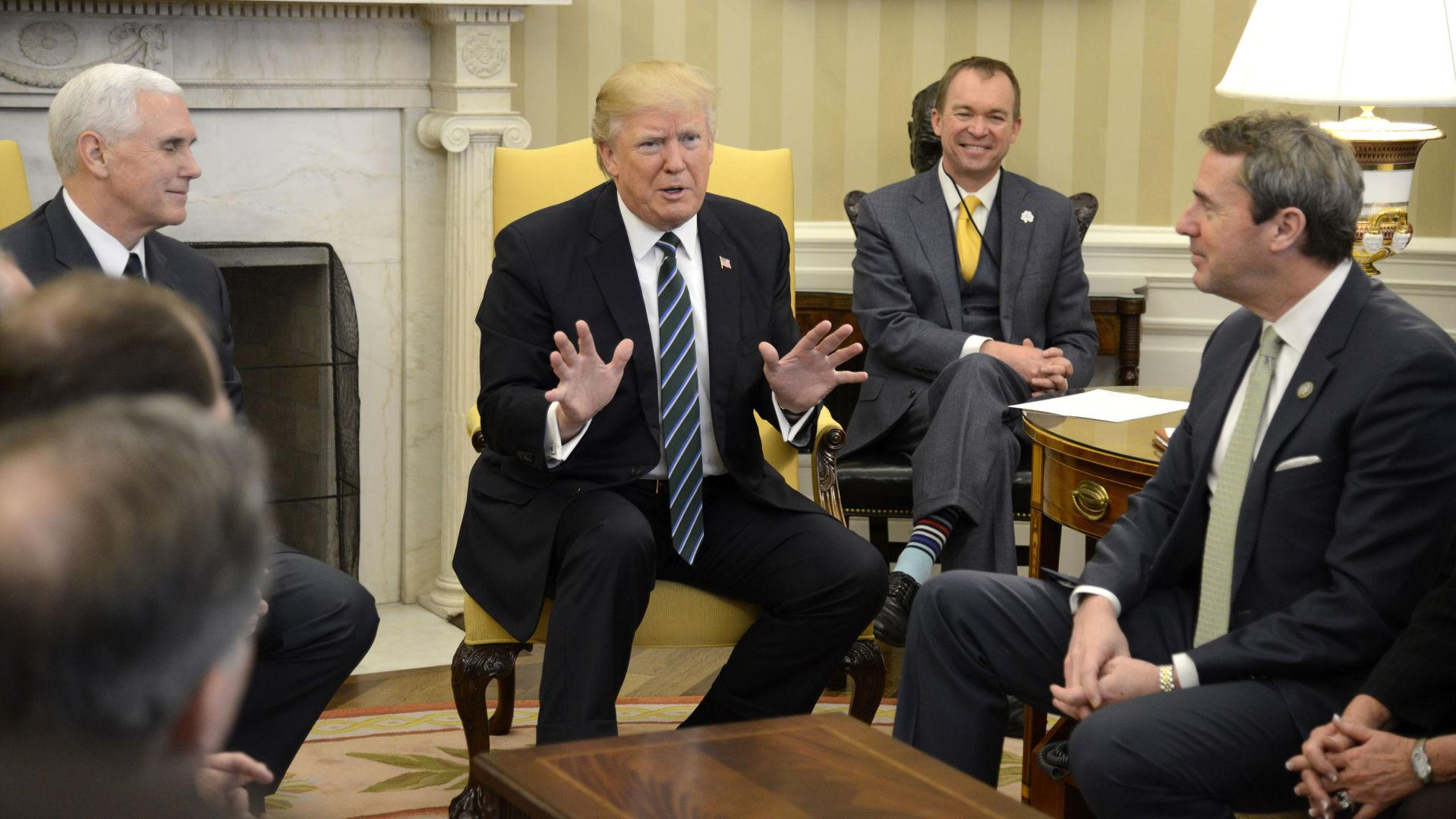 President Donald Trump (C) makes remarks as Vice President Mike Pence (L) listens as they meet with the Republican Study Committee in the Oval Office of the White House on March 17, 2017 in Washington, DC. (Mike Theiler/UPI/Abaca Press/TNS)