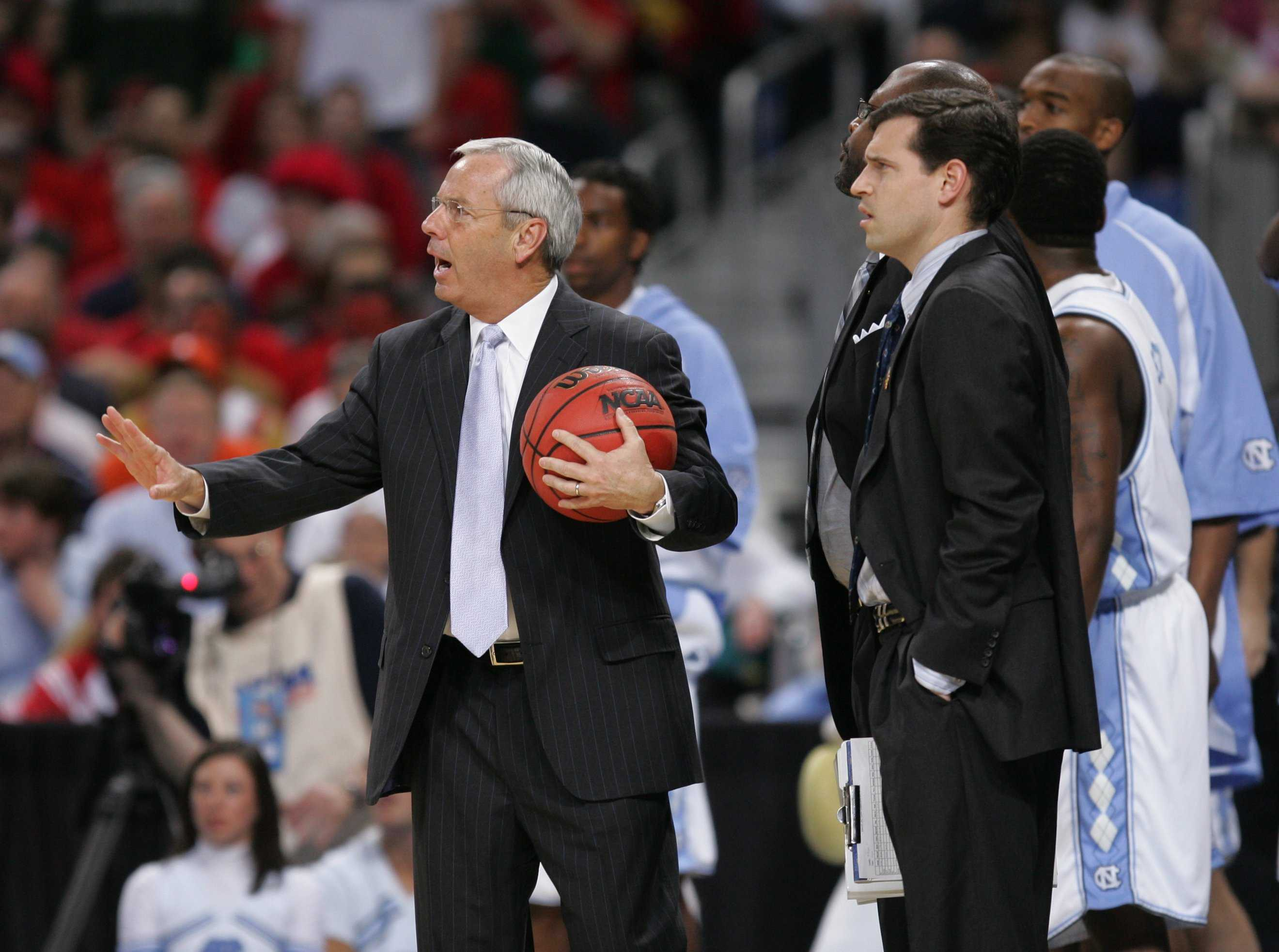 (April 2) ST. LOUIS, MO - North Carolina head coach Roy Williams, left and assistant coach C.B. McGrath watch as referees break up an altercation between Michigan State and North Carolina during the first half in the semifinal game of the Men's NCAA Final Four basketball tournament in St. Louis, Missouri, Saturday, April 2, 2005. (lde) 2005