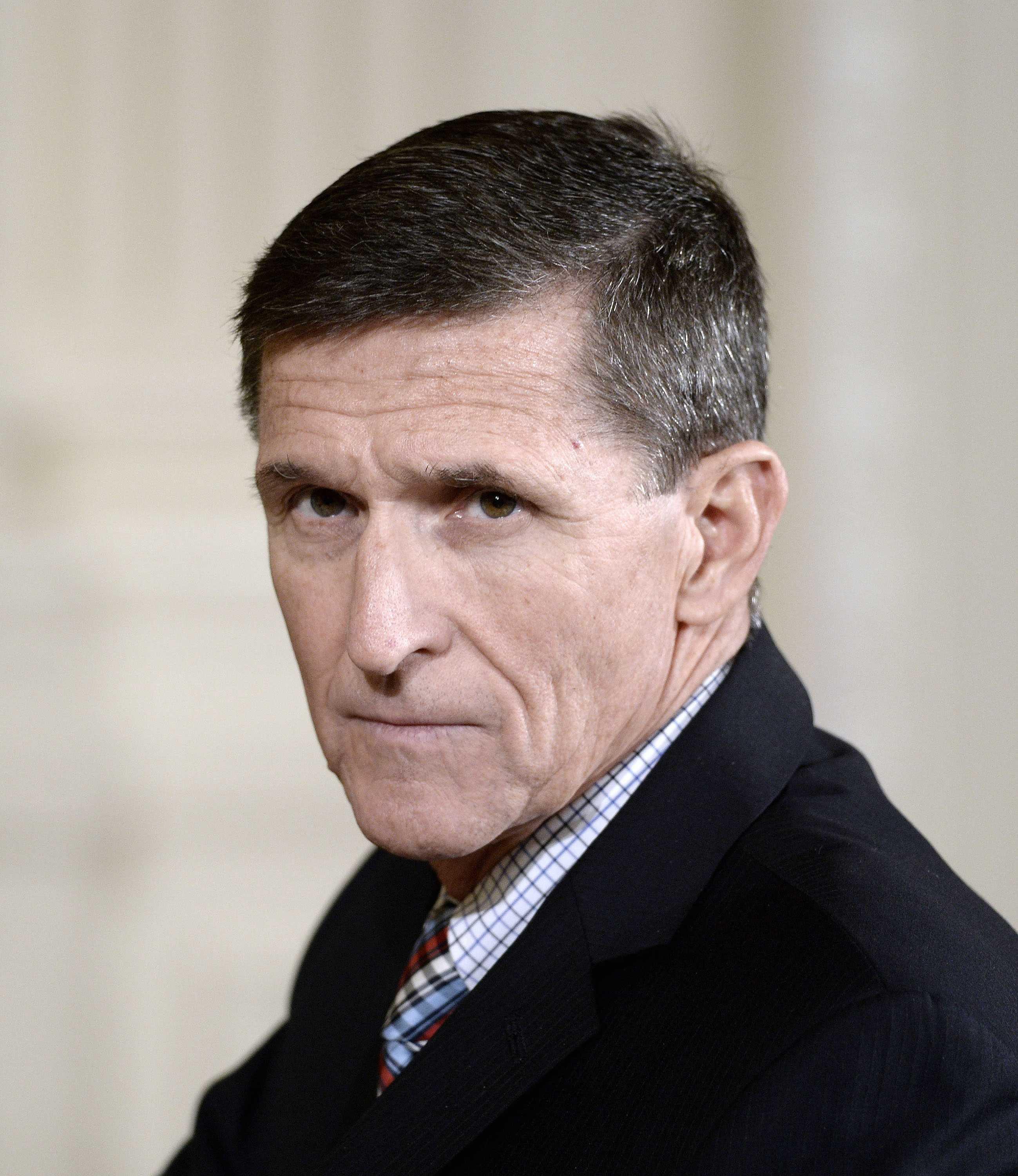 Michael Flynn attends a news conference on February 10, 2017, at the White House in Washington, D.C. Four Democratic senators have charged in a series of letters that the appointment of Flynn as Donald Trump's national security adviser