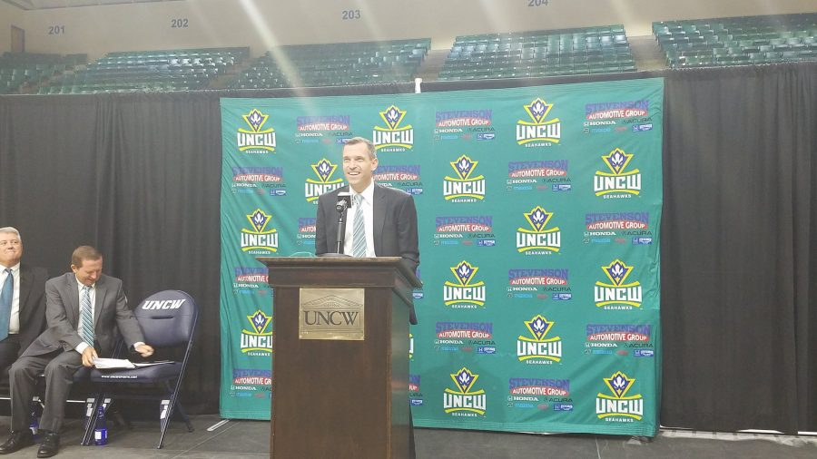 C.B.+McGrath+greets+UNCW+fans+with+a+smile+during+the+opening+press+conference+welcoming+him+as+the+next+UNCW+head+coach.