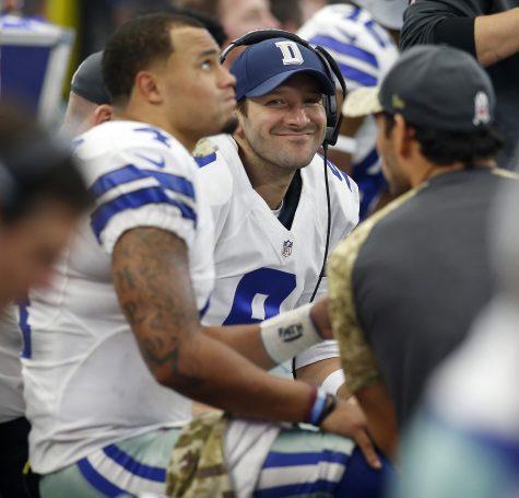 Dallas Cowboys quarterback Tony Romo (9) smiles as he talks with quarterback Dak Prescott (4) on the bench in the second half of a game against the Baltimore Ravens on Sunday, Nov. 20, 2016 at AT&T Stadium in Arlington, Texas. The Cowboys won 27-17. (Brad Loper/Fort Worth Star-Telegram/TNS)