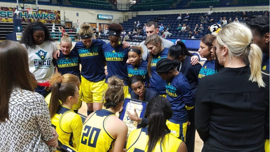 Adell Harris, center, talks to her team before tipoff vs. College of Charleston this past season.