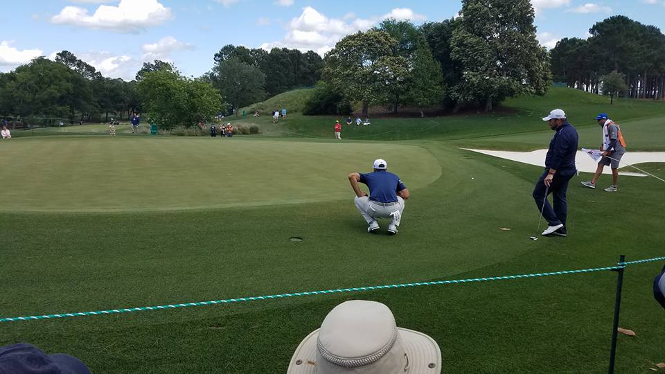 Dustin+Johnson+reading+the+green+on+hole+one