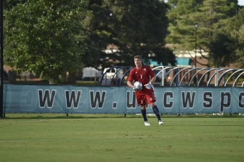 Goalkeeper Ryan Cretens fields the ball in a game during the 2016 UNCW men's soccer season.