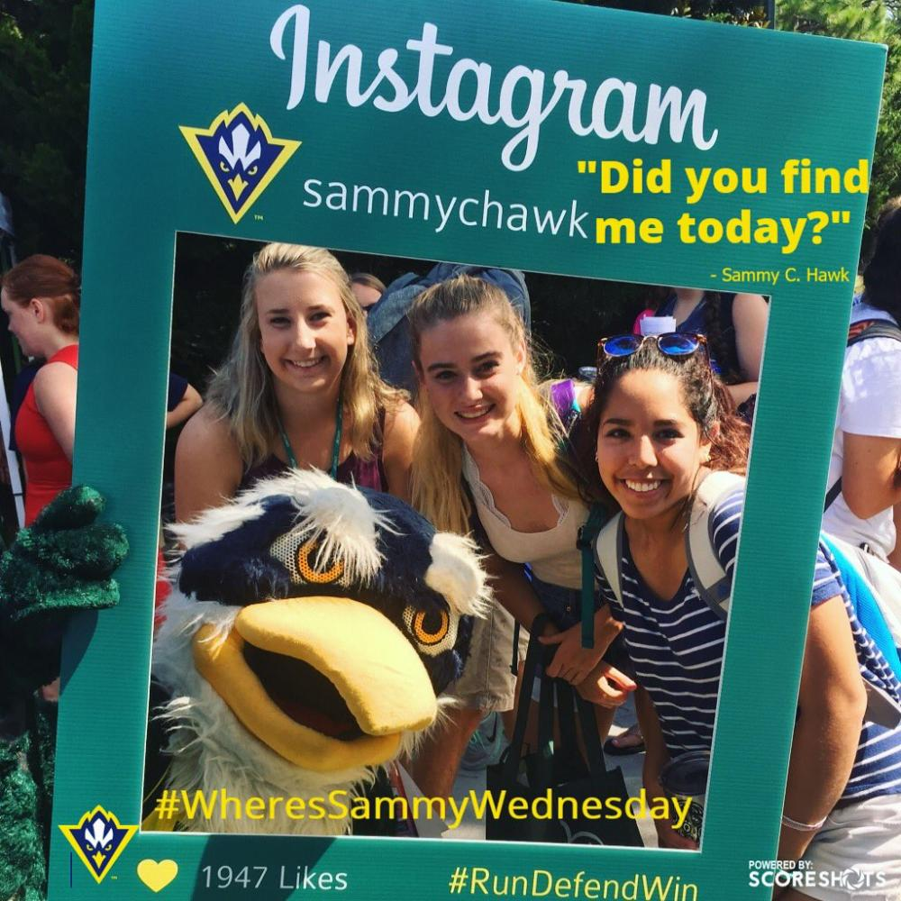 Sammy C. Hawk, left, snaps a selfie with students during Wednesday's involvement carnival just hours after losing to North Texas mascot Scrappy in the Mid-Major Madness Mascot Melee. (Source: Twitter)