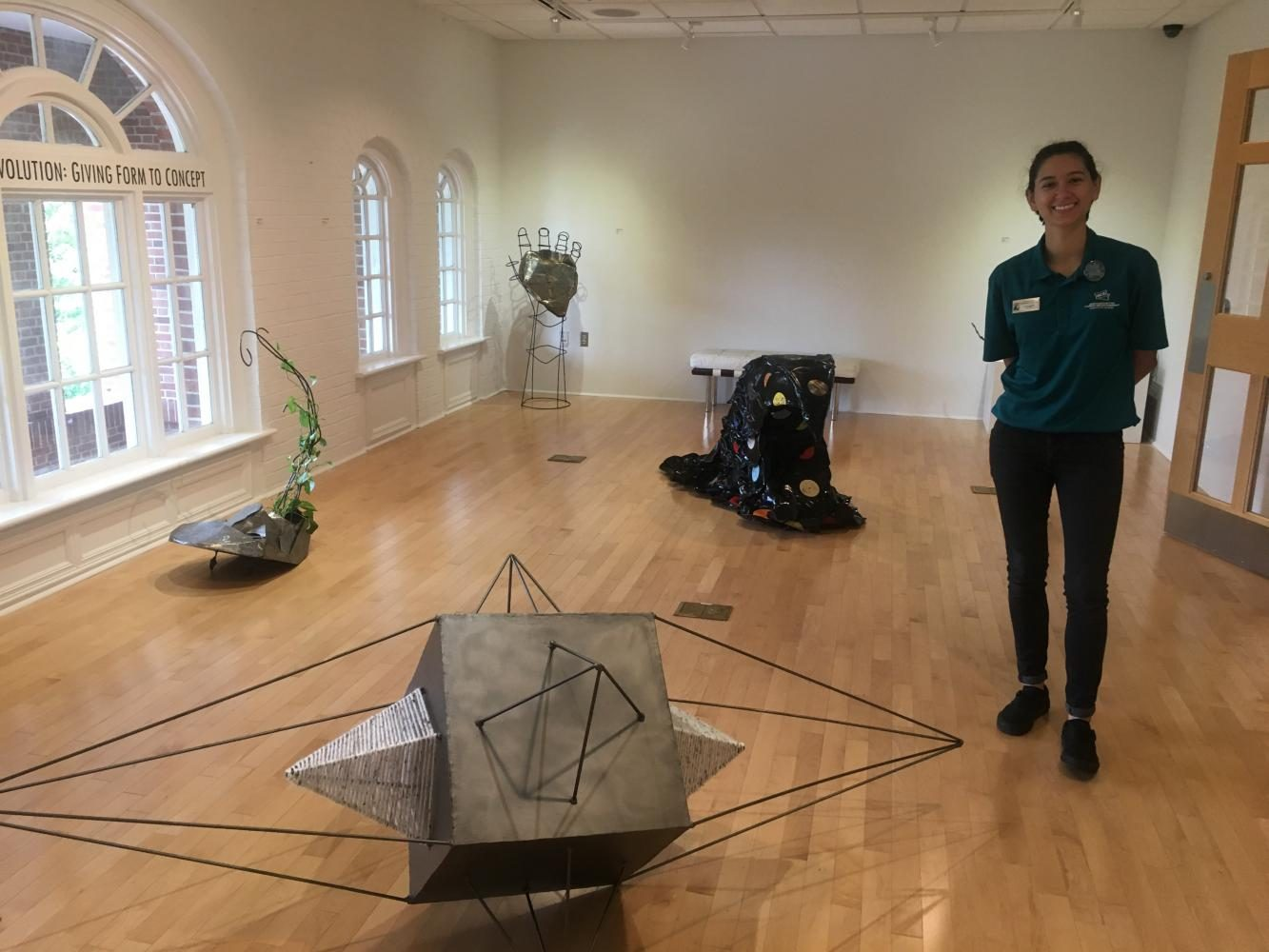 Catarina Mendez, Arts Chair for the Association for Campus Entertainment, in UNCW's Boseman Art Gallery.