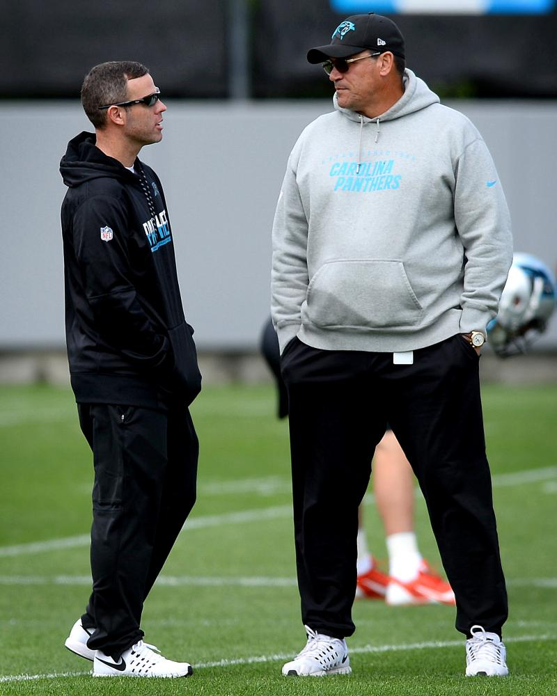 Carolina Panthers assistant general manager Brandon Beane, left, and head coach Ron Rivera talk during the second session of the team's rookie minicamp in Charlotte, N.C., on Friday, May 5, 2017. (Jeff Siner/Charlotte Observer/Tribune News Service)