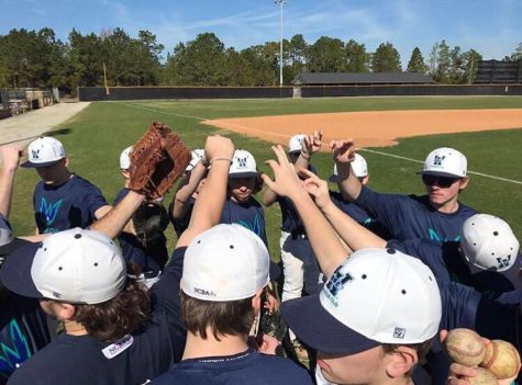 UNC Wilmington's club baseball team gets ready to break a huddle during practice.