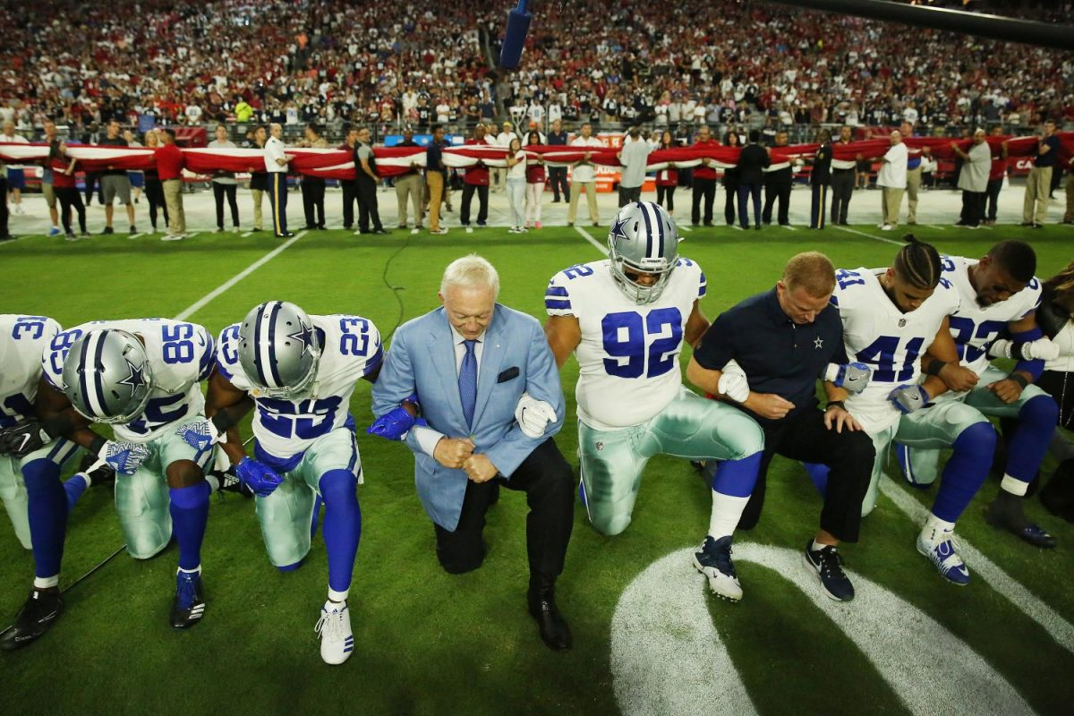 Dallas Cowboys players and staff including owner Jerry Jones and head coach Jason Garrett all take a knee before the singing of the National Anthem prior to the start of a game against the Arizona Cardinals at University of Phoenix Stadium Monday, Sept. 25, 2017 in Glendale, Ariz.