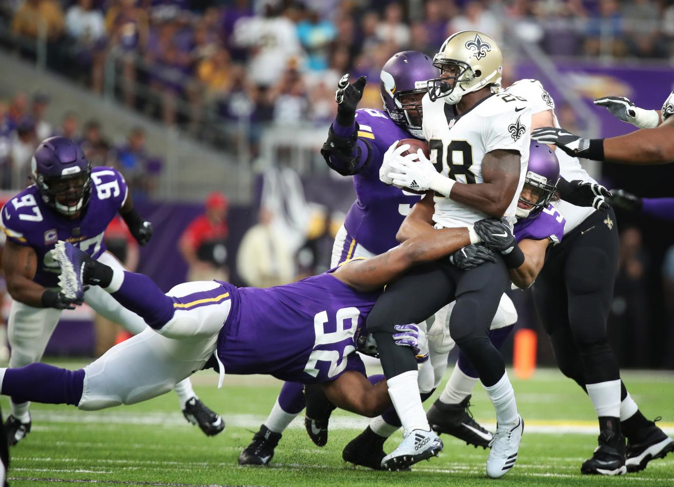 New Orleans Saints running back Adrian Peterson (28) is stopped for no gain by Minnesota Vikings defensive tackle Tom Johnson (92), and middle linebacker Eric Kendricks (54) in the first quarter Monday night, Sept. 11, 2017 at U.S. Bank Stadium in Minneapolis, Minn. The Vikings won, 29-19.