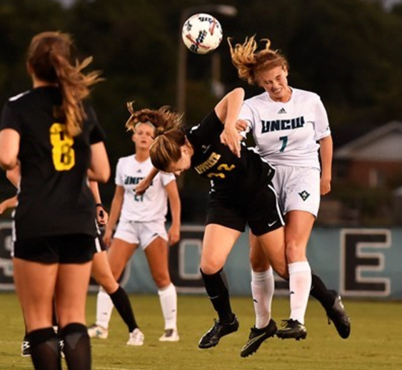 UNCW's Molly McGarry (7, right puts her head to use in the Seahawks' game vs. Appalachian State on Saturday, Sept. 9, 2017.