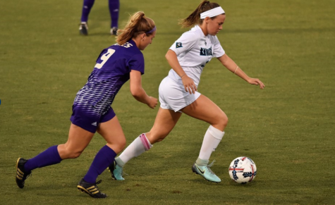 Savannah Andrews weaves her way through the James Madison defense in UNC Wilmington's 3-0 victory on Thursday, Sept. 28.