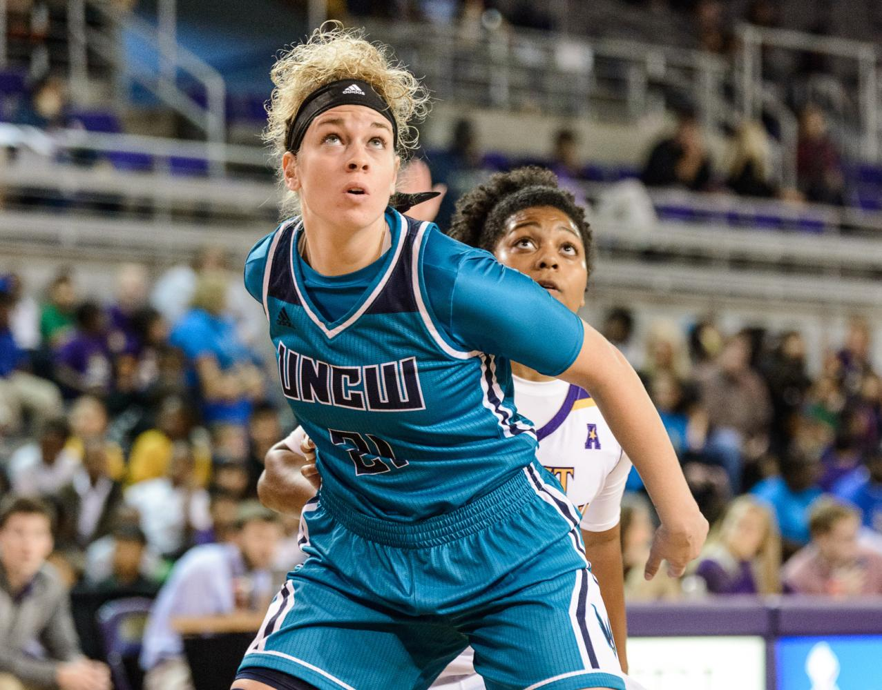 Jenny DeGraaf (21) posts up a East Carolina defender in a game during the 2016-2017 UNCW women's basketball season.