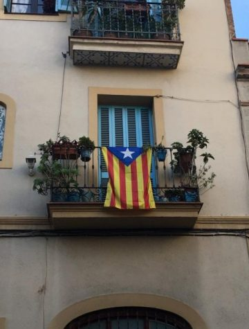 The Catalan Independence Flag hangs over a home's balcony in Barcelona, the capital of Catalonia.