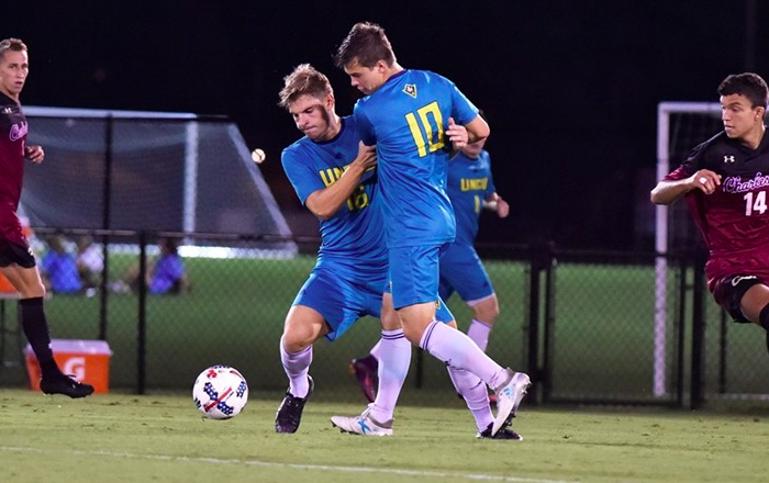 UNCW's Emil Elveroth (16) and Phillip Goodrum (10) get tangled up with one another during the Seahawks' 2-1 loss to College of Charleston on Wednesday, Oct. 11.