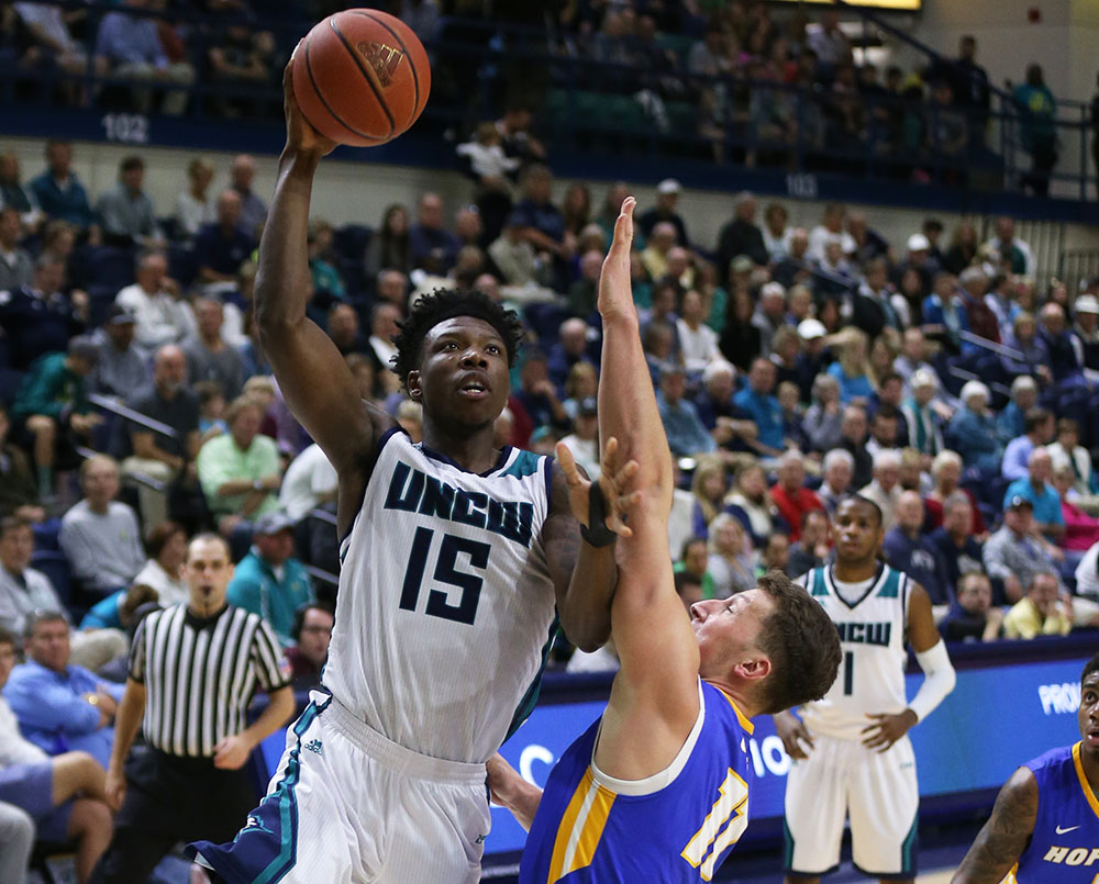 Devontae Cacok (15) goes up for a basket in a home game vs. Delaware during UNCW's 2017 basketball season.