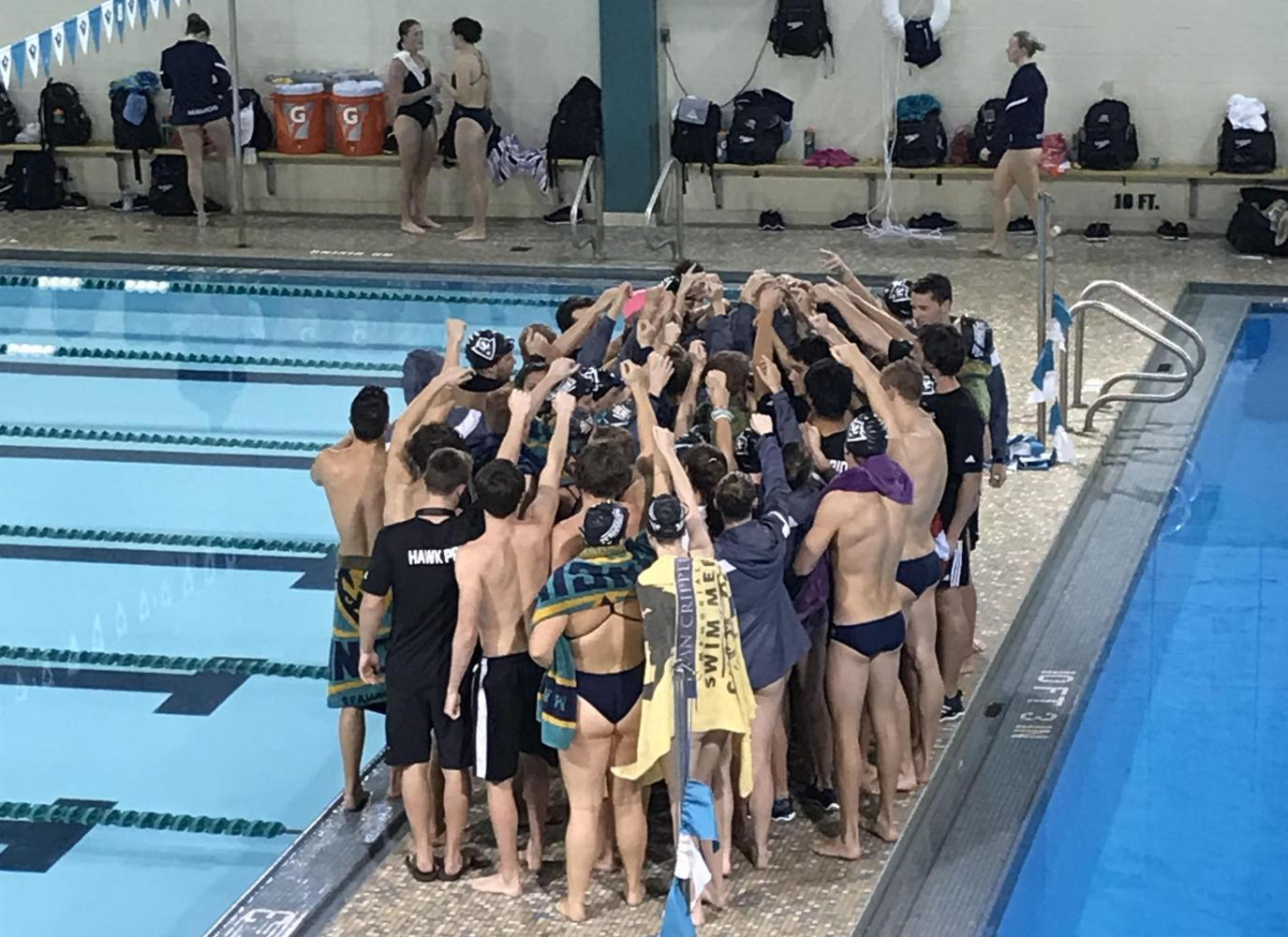 The UNCW men's and women's swimming and diving teams gather after their respective wins over Old Dominion on Saturday, Oct. 14.