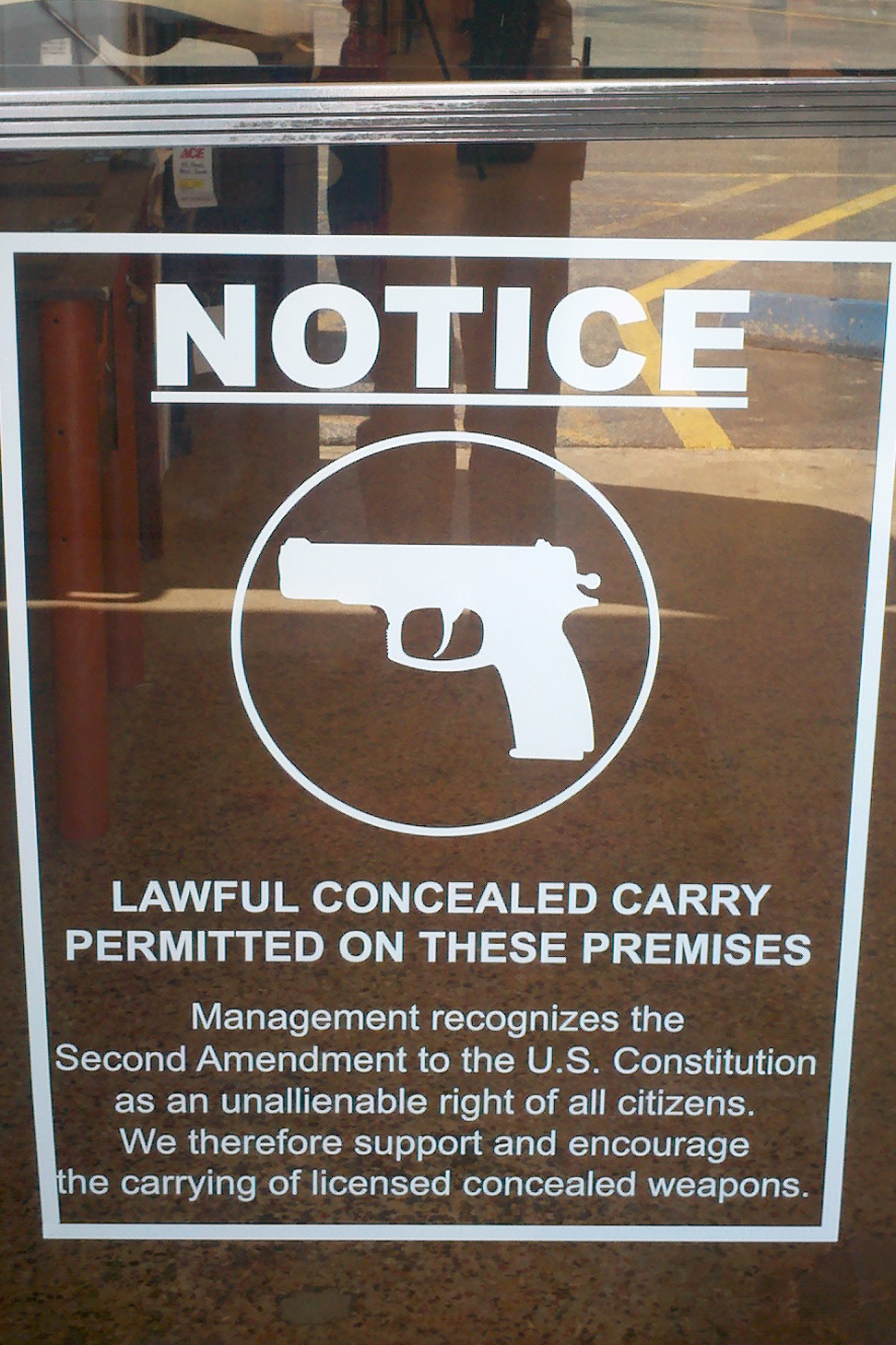 Flickr user wiz722 captured this sign indicated legal carrying of guns in Harris, Texas in 2011.