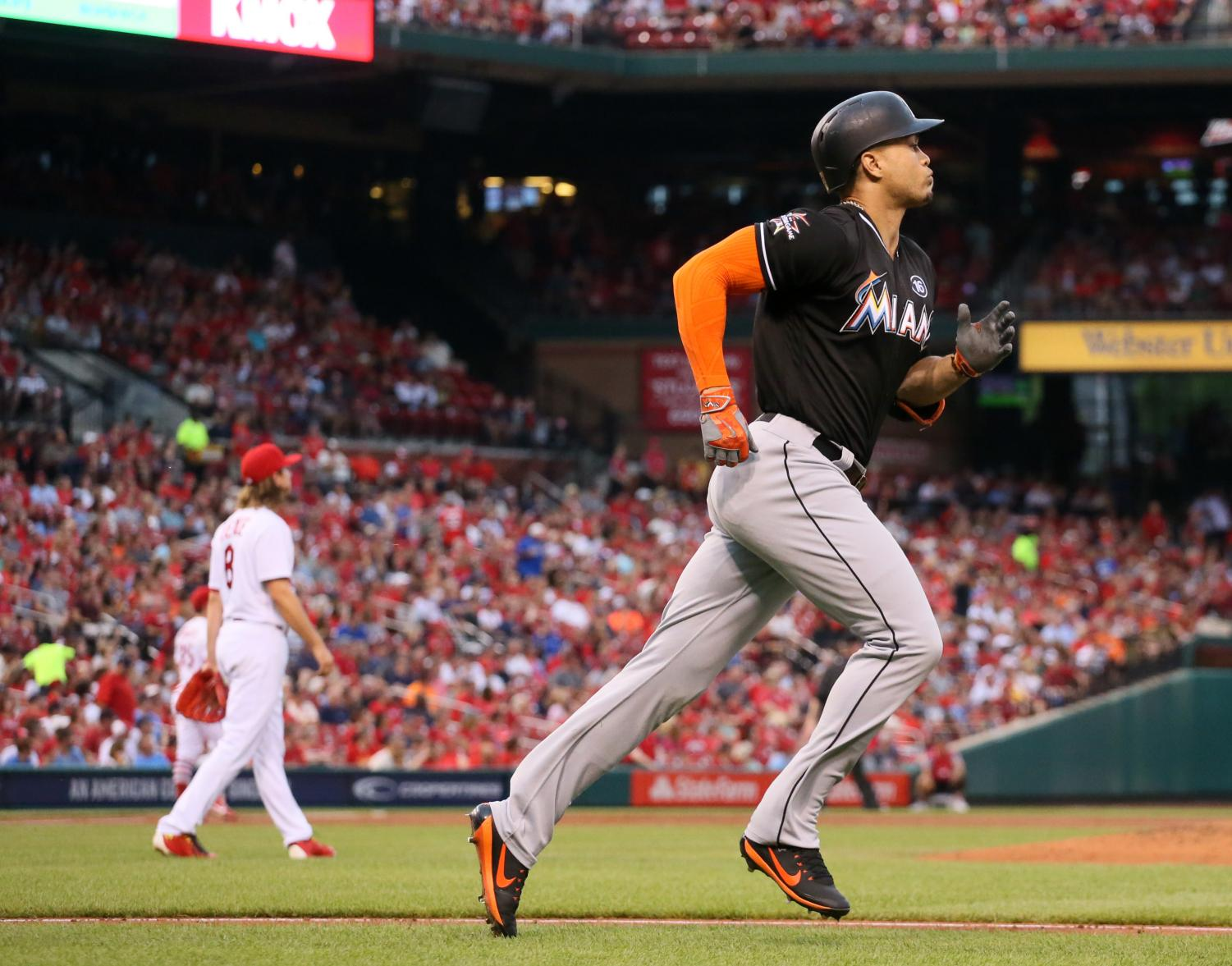 The Miami Marlins' Giancarlo Stanton, right, rounds the bases after hitting a two-run home run against the St. Louis Cardinals on July 5, 2017, at Busch Stadium in St. Louis.