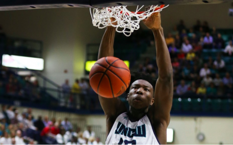 Devontae Cacok slams a ball through the hoop in UNCW's 88-84 win over Campbell on Saturday.