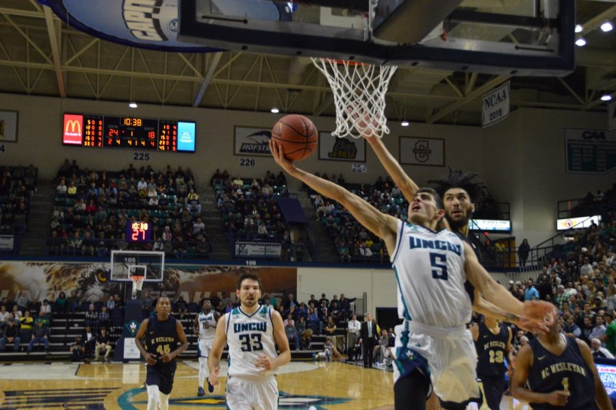 Jeffrey+Gary+goes+for+the+hoop+in+UNCW%27s+105-81+win+over+N.C.+Wesleyan+on+Saturday%2C+Nov.+11.