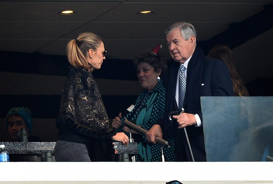 Carolina Panthers team owner Jerry Richardson, right, arrives in the owner's box at Bank of America Stadium on Sunday, Dec. 17, 2017 prior to the team's game against the Green Bay Packers.