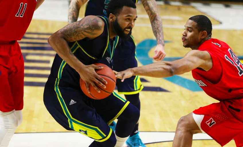 UNCW's Jordon Talley fights through Northeastern's defense in Saturday's 81-77 overtime loss.