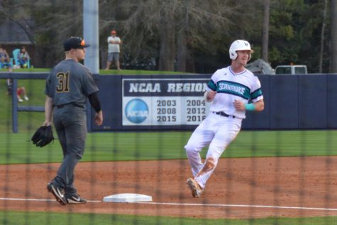 No. 36 Kep Brown steals third base following a wild pitch on Friday, Feb. 23.