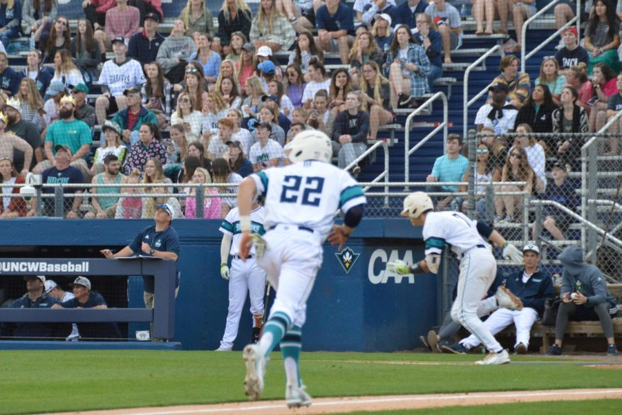 No. 7 Jackson Meadows and No. 22 Noah Bridges run to first base and home respectively following a pop-fly hit to center field by Meadows.