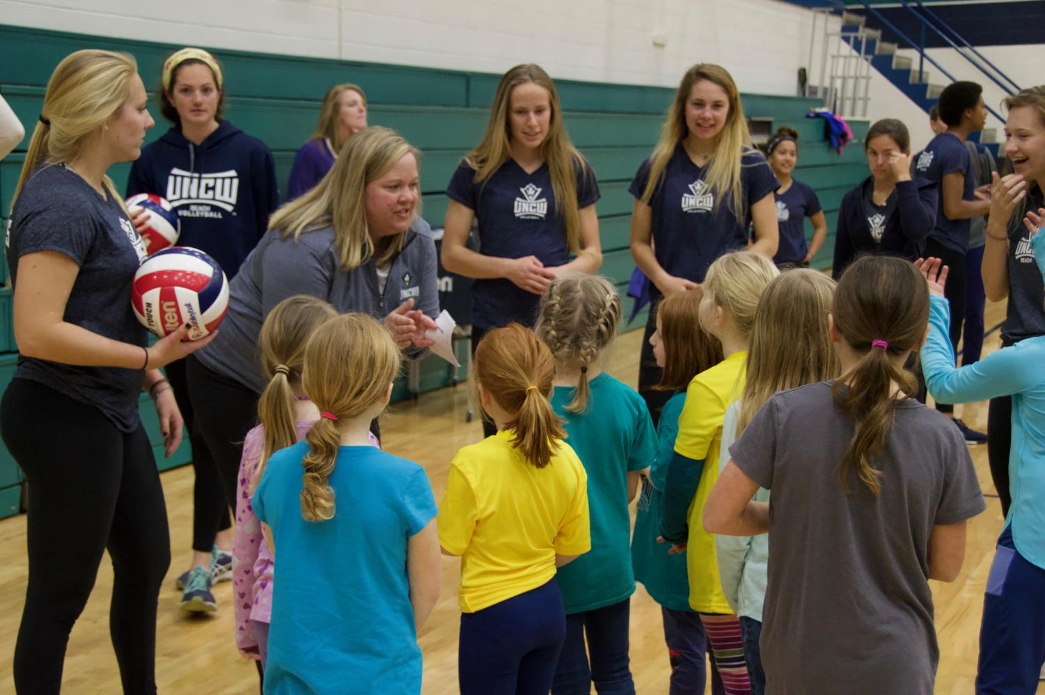 Volleyball+coach+Amy+Bambenek+speaks+to+a+group+of+young+ladies