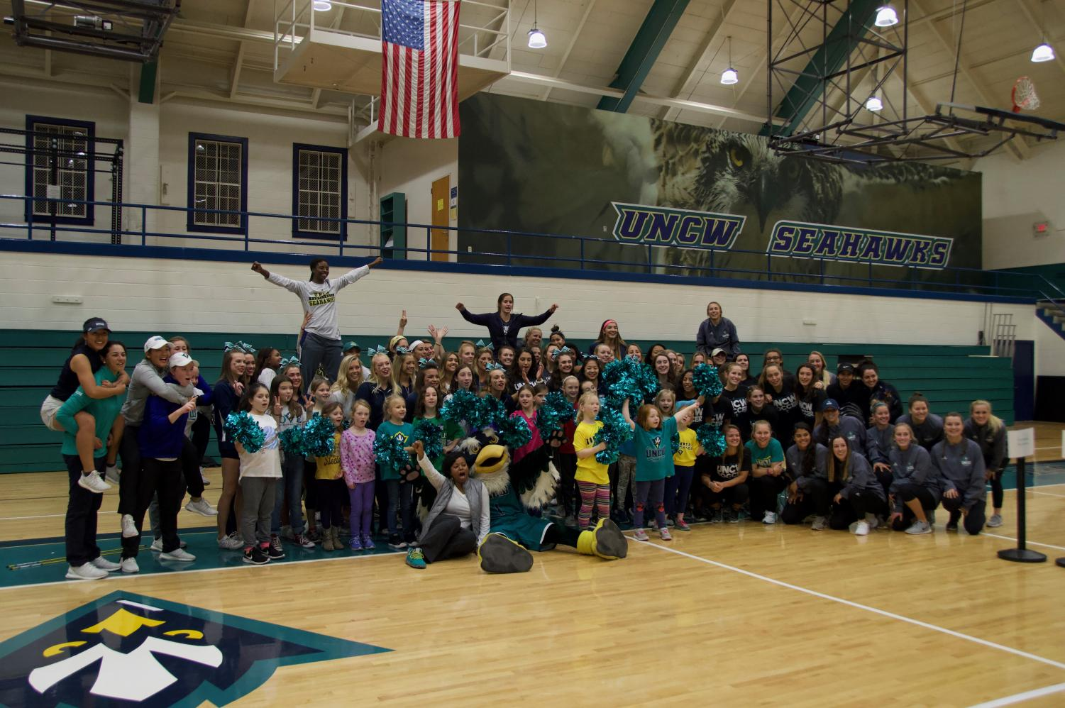 UNCW women's sports teams and young female athletes gathered for a group picture at Friday's National Girls and Women in Sports Day event.