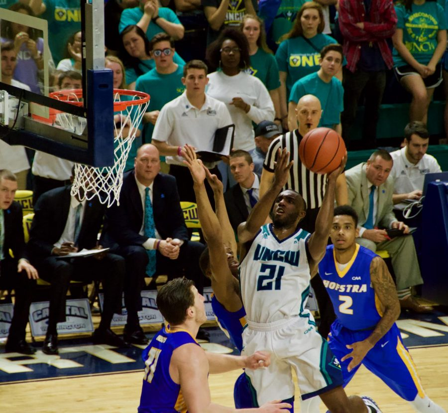 No. 21 Ty Taylor attempts a layup